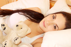 Beautiful young girl in bed in the morning Stock Images