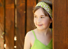 Beautiful young girl behind the wooden door Royalty Free Stock Images