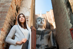 Beautiful young girl  and big buddha Stock Photography
