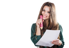 Beautiful young girl with a big piece of paper and a pencil on a white background Stock Photos