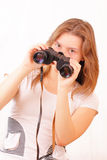 Beautiful young girl with binoculars Royalty Free Stock Photography