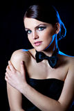 Beautiful young girl with black bow tie Royalty Free Stock Photo