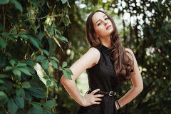 Beautiful young girl in black dress with long hair, super cute a Stock Photography