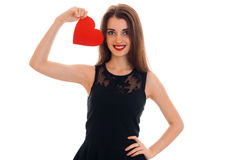 Beautiful young girl in a black dress rose in hand Valentine and smiling. Isolated on white background stock photo
