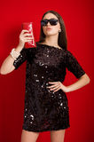 Beautiful young girl in a black dress and sunglasses Royalty Free Stock Photos