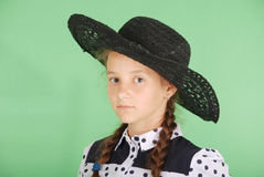Beautiful young girl in black  hat on his head Royalty Free Stock Images