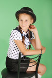 Beautiful young girl in black  hat on his head Stock Image