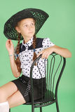Beautiful young girl in black  hat on his head Stock Photo
