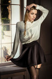 Beautiful young girl in black skirt Royalty Free Stock Photo