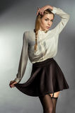 Beautiful young girl in black skirt Royalty Free Stock Photography
