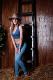 Beautiful young girl with blond hair wearing cowboy hat Stock Photography