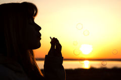 Beautiful young girl blow bubbles on nature Stock Photos
