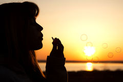 Beautiful young girl blow bubbles on nature Royalty Free Stock Photos