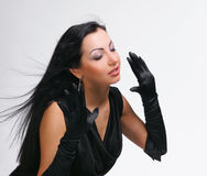 Beautiful young girl with blowing hair in black dress Stock Photos