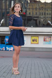 Beautiful young girl in blue dress. Is standing Stock Images
