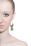 Beautiful young girl with blue eyes, isolated. Beautiful young woman with blue eyes and green earring isolated on white stock images
