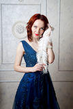 Beautiful young girl with blue eyes posing at interior photo stu Royalty Free Stock Photography