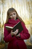 Beautiful young girl with a book Stock Photos