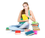Beautiful young girl and books Stock Photos