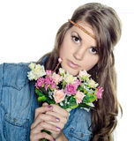 Beautiful young girl with a bouquet Stock Photography