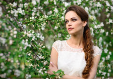 Beautiful young girl with braided hair in the park. Royalty Free Stock Photography