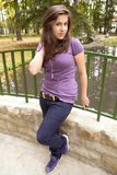 Beautiful young girl on bridge in the park 2 Stock Photography