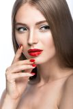 Beautiful young girl with a bright make-up and red nails. Beauty face. Royalty Free Stock Images