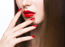 Beautiful young girl with a bright make-up and red nails. Stock Photos