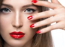 Beautiful young girl with a bright make-up and red Royalty Free Stock Photo