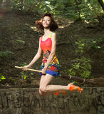 Beautiful young girl on broomstick stock photography