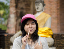Beautiful young girl and buddha at Wat Yai Chai Mongkol Temple Stock Images