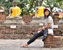 Beautiful young girl and buddha at Wat Yai Chai Mongkol Temple Royalty Free Stock Photography