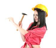 Beautiful young girl-builder  holding hammer Stock Photos