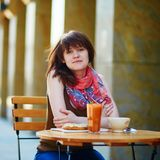 Beautiful young girl in cafe Stock Photography