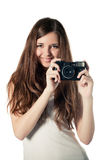 Beautiful young girl with camera Stock Image