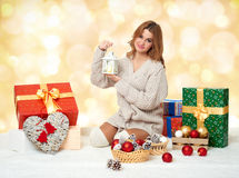 Beautiful young girl with candle lantern and gift boxes - holiday concept Royalty Free Stock Images