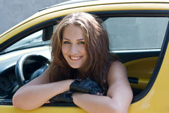 Beautiful young girl in the car Stock Photos