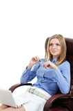 Beautiful young girl in a chair Stock Photography