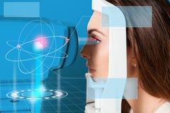 Beautiful young girl checks eyesight on Autoceratorefractometers Stock Photos