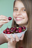 Beautiful young girl with cherries Stock Image