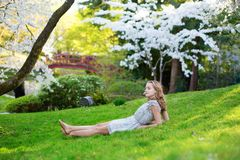 Beautiful young girl in cherry blossom garden Royalty Free Stock Images