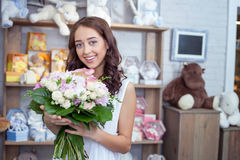 Beautiful young girl is choosing flowers in store Stock Photo