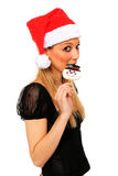 Beautiful young girl with christmas hat Royalty Free Stock Image