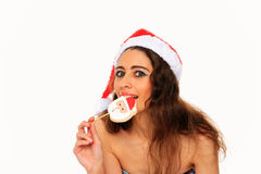 Beautiful young girl with christmas hat Stock Photo