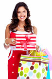 Beautiful young girl with a Christmas present. Royalty Free Stock Image