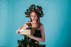 Beautiful young girl in a Christmas tree costume royalty free stock image