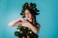 Beautiful young girl in a Christmas tree costume stock photography