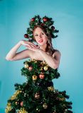 Beautiful young girl in a Christmas tree costume stock photos