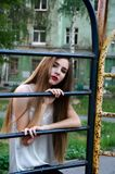 Beautiful young girl in the old yard. Beautiful young girl in the city style walk in the old courtyard Royalty Free Stock Photos