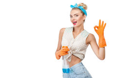 Beautiful young girl is cleaning her house Stock Image